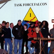 One last song for the Troops in Kosovo. L-R William Cohen (Secretary of Defense) and wife Janet, Ty Murray (Champion Rodeo Cowboy), Jewel (singer), Howard (Buck) McKeon (California Congressman), Jerry Bruckheimer (film producer), David L. Hobson (Ohio Congressman), Terry Bradshaw (football star)Susan Collins (Maine Senator), Shane Minor (country singer), Carole King, Mike Singletary (football star), Ruth Pointer-Sayles (singer), Al Rascone (Medal of Honor recipient) and two Dallas Cowboy Cheerleaders. Photo
