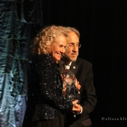Neil Portnow, President of N.A.R.A.S. presents Carole King with Musicares POTY Award