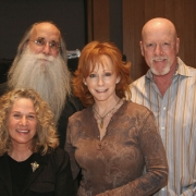 Pictured in the photo with Carole and Reba are: L-R: Leland Sklar (bass) and Russ Kunkel (drums). Photo by Glenn Sweitzer