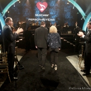 Carole King is escorted to the stage by her son Levi Larkey. Photo by Elissa Kline