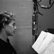 "Carole in the vocal booth with the lyrics to ""Short Mort"" on the music stand.  Photos Courtesy of Sony Music Entertainment Archive"