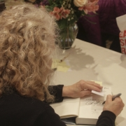 Carole signing books at Sun Valley Wellnes Festival. Photo by Elissa Kline