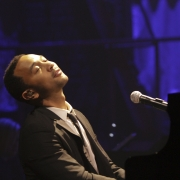 "John Legend performing ""You've Got A Friend"".  Photo by Elissa Kline"