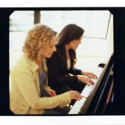 Vanessa and Carole play piano.  Photo by Jim Wright